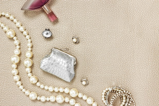 Silver purse, jewelry and perfume