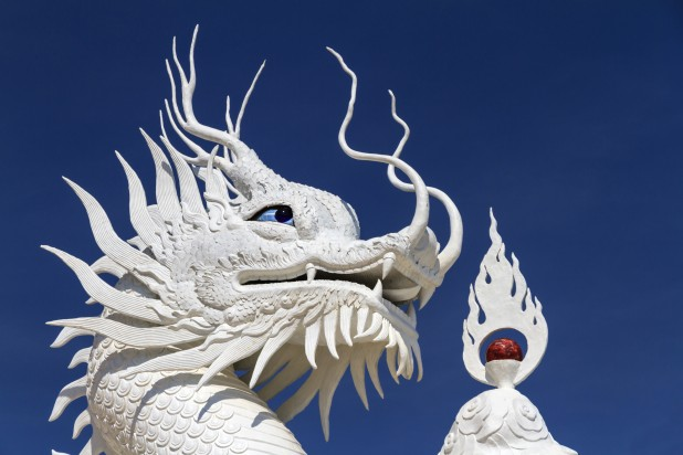Chinese white dragon on blue background.