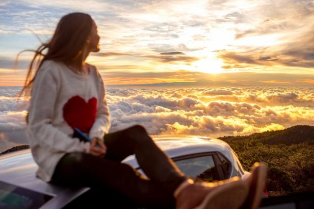 Woman enjoying beautiful cloudscape