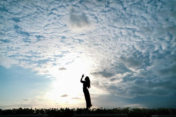 Asian women do yoga under the sky